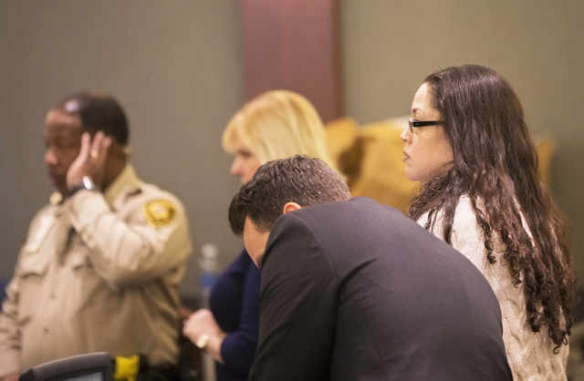 Brandy Stutzman, right, stands a court recess during  closing arguments in her death penalty murder trial on Friday, Jan. 27, 2017, at the Regional Justice Center, in Las Vegas. Stutzman is charge ...