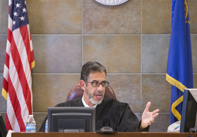 Judge Michael Villani addresses defense attorney Lisa Rasmussen during a court recess during closing arguments in the death penalty murder trial of Brandy Stutzman on Friday, Jan. 27, 2017, at the ...