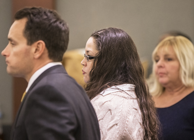 Brandy Stutzman, middle, stands in the courtroom with defense lawyers Josh Tomsheck, left, and Lisa Rasmussen during closing arguments in her death penalty murder trial on Friday, Jan. 27, 2017, a ...