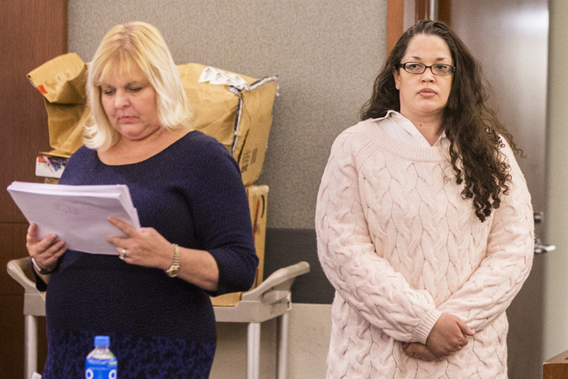 Brandy Stutzman, right, and defense attorney Lisa Rasmussen walk into the courtroom during closing arguments in her death penalty murder trial on Friday, Jan. 27, 2017, at the Regional Justice Cen ...
