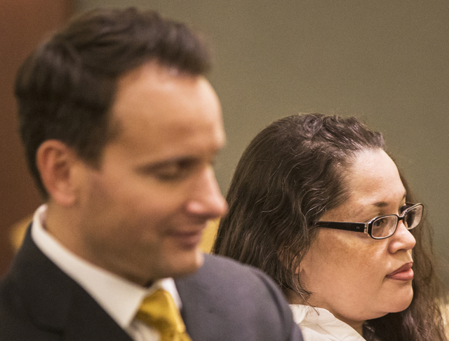 Brandy Stutzman, right, stands in the courtroom with her defense attorney Josh Tomsheck during closing arguments in her death penalty murder trial on Friday, Jan. 27, 2017, at the Regional Justice ...