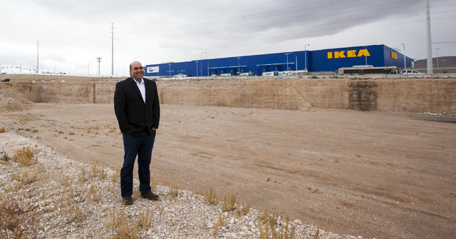 Listing broker Aman Lal stands on a plot of land at the southeast corner of Sunset Road and Durango Drive that has been vacant since 2008 in Las Vegas on Thursday, Jan. 19, 2017. The location was  ...