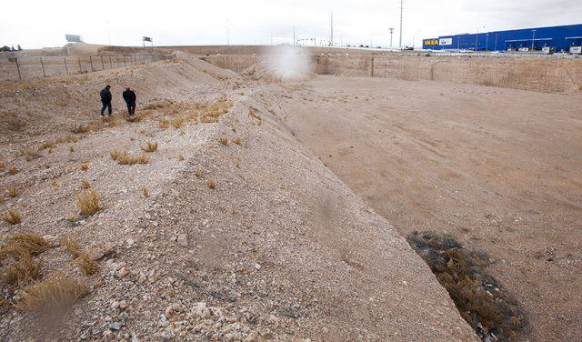 Listing broker Aman Lal and a reporter explore a plot of land at the southeast corner of Sunset Road and Durango Drive that has been vacant since 2008 in Las Vegas on Thursday, Jan. 19, 2017. The  ...