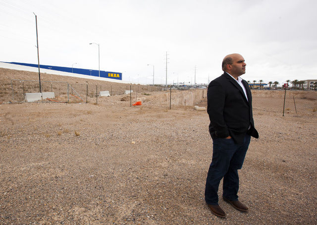 Listing broker Aman Lal speaks to a reporter explore about a plot of land at the southeast corner of Sunset Road and Durango Drive that has been vacant since 2008 in Las Vegas on Thursday, Jan. 19 ...