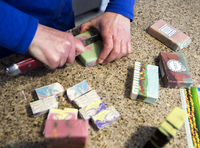 Carmen Iclodean, owner of Earth's Raw Beauty, cuts samples of handmade soaps in her southwest valley home on Monday, Jan. 23, 2017. (Jeff Scheid/Las Vegas Review-Journal)@jeffscheid