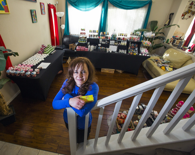 Carmen Iclodean, owner of Earth's Raw Beauty, stands in her living room full of handmade soaps and lotions on Monday, Jan. 23, 2017. (Jeff Scheid/Las Vegas Review-Journal)@jeffscheid