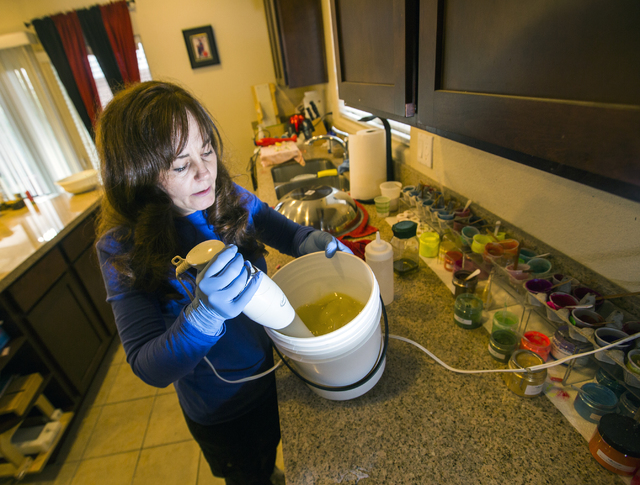 Carmen Iclodean, owner of Earth's Raw Beauty, mixes handmade soaps in her southwest valley home on Monday, Jan. 23, 2017. (Jeff Scheid/Las Vegas Review-Journal)@jeffscheid