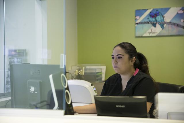 Front desk receptionist Chila Poling works at the Sun Valley medical marijuana certifications clinic on Wednesday, Jan. 4, 2017, in Las Vegas. Erik Verduzco/Las Vegas Review-Journal Follow @Erik_V ...
