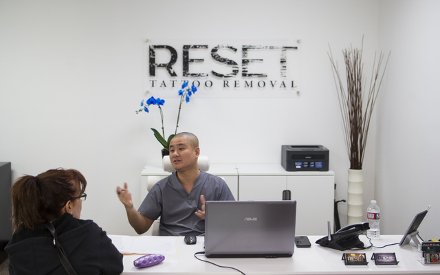 Blake Yeh finishes a session with Kim, who didn't want to give her last name, at Reset Tattoo Removal in Las Vegas on Friday, Dec. 30, 2016. (Chase Stevens/Las Vegas Review-Journal) @csstevensphoto