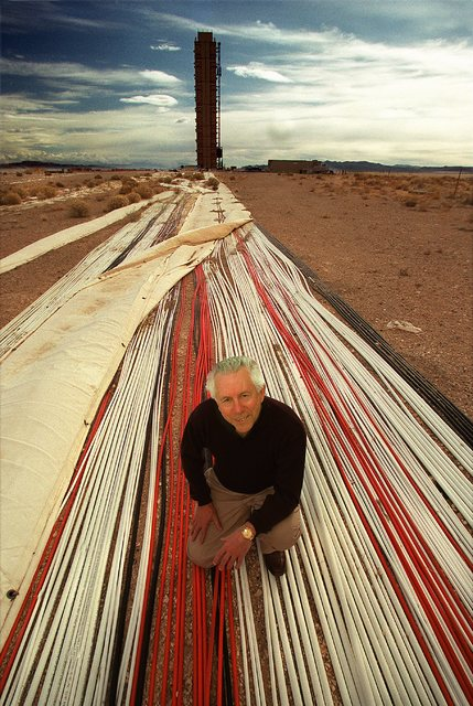 Former Nevada Test Site Manager Nick Aquilina kneels on diagnostic cables leading to the Icecap Tower at the Nevada Test Site, 65 miles northwest of Las Vegas, in the fall of 2000. (FILE/Las Vegas ...