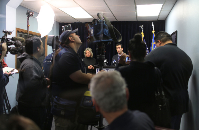 Representatives Dina Titus, D-Nev., center left, and Ruben Kihuen, D-Nev., center right, condemn the temporary immigration ban during a press conference at Dina Titus' office on Saturday, Jan. 28, ...
