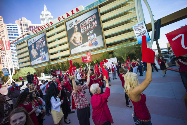 Attendees cheer during a rally celebrating National Travel & Tourism Week at Toshiba Plaza in Las Vegas on Tuesday, May 3, 2016. Chase Stevens/Las Vegas Review-Journal Follow @csstevensphoto