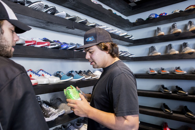 Kolton Huff, center, shops at Capital Sneaker Boutique in Towns Square, Las Vegas, Monday, Jan. 28, 2017. (Elizabeth Brumley/Las Vegas Review-Journal) @EliPagePhoto