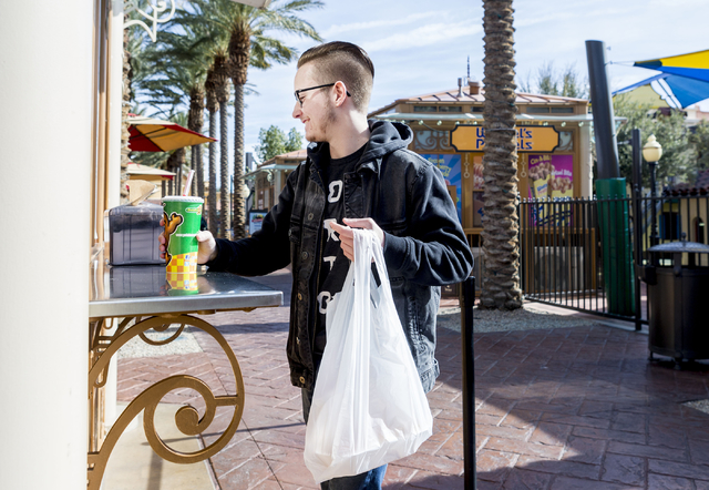 Slade Deiter picks up his order at Potato Corner, located in Town Square, Las Vegas, Monday, Jan. 30, 2017.  (Elizabeth Brumley/Las Vegas Review-Journal) @EliPagePhoto