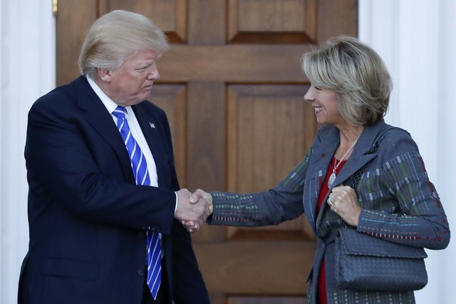 President-elect Donald Trump and Betsy DeVos shake hands at Trump National Golf Club Bedminster clubhouse in Bedminster, N.J., Saturday, Nov. 19, 2016. (AP Photo/Carolyn Kaster)