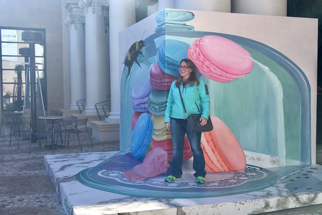Visitor Megan Nobles from Colorado poses with the macaroon mural at Monte Carlo Resort and Casino on Friday, January 27, 2017. (Caitlin Lilly/Las Vegas Review-Journal)