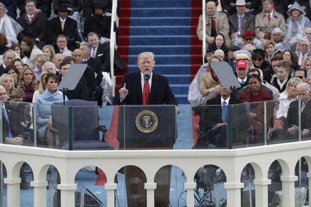 President Donald Trump delivers his inaugural address after being sworn in as the 45th president of the United States during the 58th Presidential Inauguration at the U.S. Capitol in Washington, F ...