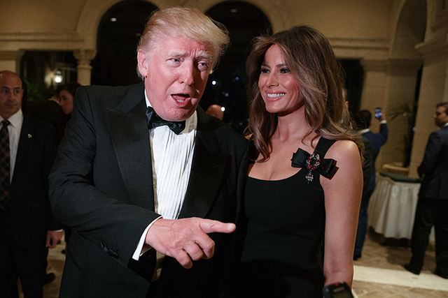 Melania Trump looks on as her husband, President-elect Donald Trump, talks to reporters during a New Year's Eve party at Mar-a-Lago, Saturday, Dec. 31, 2016, in Palm Beach, Fla. (Evan Vucci/AP)