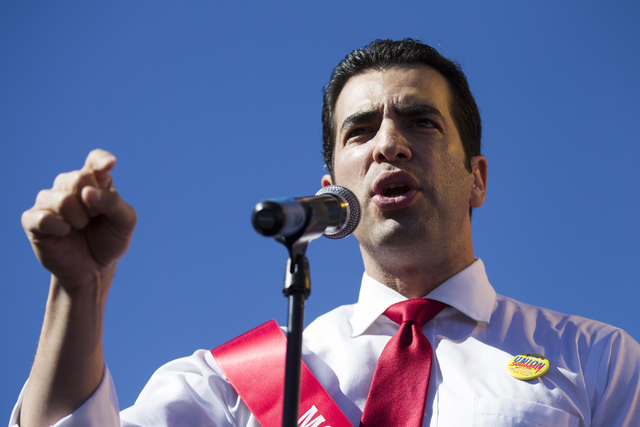 Democratic nominee for the 4th Congressional District Ruben Kihuen rallies the crowd during a protest against Republican presidential nominee Donald Trump outside of Trump International Hotel Wedn ...