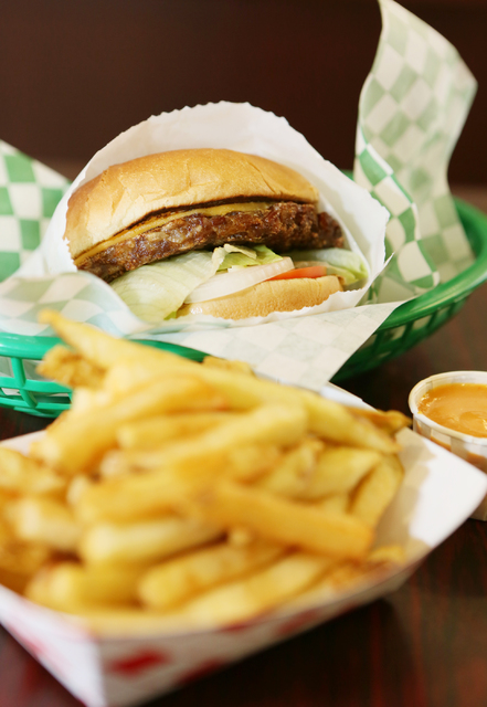 A vegan cheeseburger and French fries with a side of Cajun sauce are shown at VegeWay on Nov. 10, 2016. Ronda Churchill/View