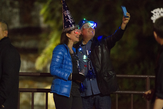 Marjorie Lester, left, and her husband David take a photo on the Strip near The Mirage hotel-casino on New Year's Eve, Saturday, Dec. 31, 2016. Erik Verduzco/Las Vegas Review-Journal Follow Erik V ...