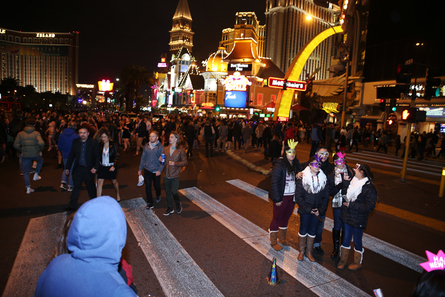People on the Strip near The Mirage hotel-casino on New Year's Eve, Saturday, Dec. 31, 2016. Erik Verduzco/Las Vegas Review-Journal Follow Erik Verduzco