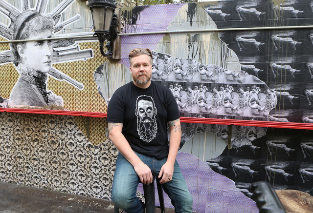 Chris Jacobs with the mural he created at Park on Fremont on Thursday, Jan. 19, 2017, in Las Vegas. (Bizuayehu Tesfaye/Las Vegas Review-Journal) @bizutesfaye