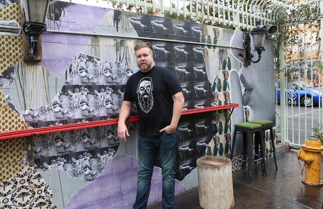 Chris Jacobs with the mural he created at Park on Fremont on Thursday, Jan. 19, 2017, in Las Vegas. (Bizuayehu Tesfaye/Las Vegas Review-Journal) @bizutesfaye