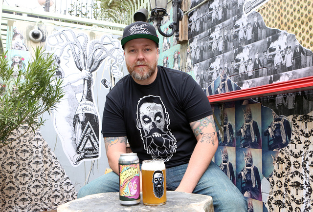 Chris Jacobs with the mural he created at Park on Fremont, and with his craft Beer and Zombies glassware on Thursday, Jan. 19, 2017, in Las Vegas. (Bizuayehu Tesfaye/Las Vegas Review-Journal) @biz ...
