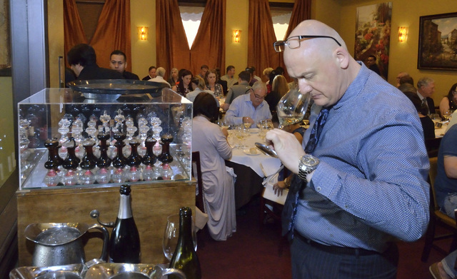 """Sommelier Paolo Uccellatori checks a glass of wine during the """"Taste and Learn"""" event at Ferraro's Italian Restaurant and Wine Bar at 4480 Paradise Road in Las Vegas on Saturday, Oct ..."""