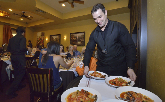 Shane Werckle prepares to serve diners at the Ҕaste and LearnӠevent at Ferraro's Italian Restaurant and Wine Bar at 4480 Paradise Road in Las Vegas on Saturday, Oct. 29, 2016. Bill Hug ...