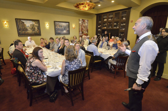 """Gino Ferraro, principal with Ferraro's Italian Restaurant and Wine Bar, talks with guests during the """"Taste and Learn"""" event at the restaurant at 4480 Paradise Road in Las Vegas on S ..."""