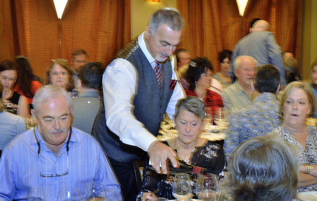 """Gino Ferraro, principal with Ferraro's Italian Restaurant and Wine Bar, pours wine for guests at the """"Taste and Learn"""" event at the restaurant at 4480 Paradise Road in Las Vegas on S ..."""