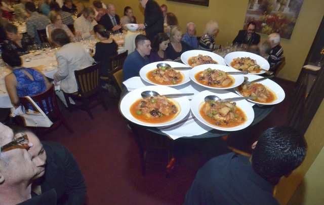 """A tray of food is brought into the dining area during the """"Taste and Learn"""" event at Ferraro's Italian Restaurant and Wine Bar at 4480 Paradise Road in Las Vegas on Saturday, Oct. 29 ..."""
