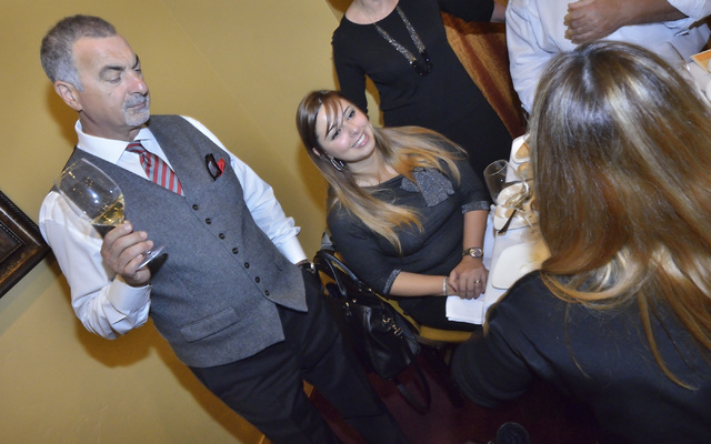 """Gino Ferraro, principal with Ferraro's Italian Restaurant and Wine Bar, left, and Letizia Patane, export manager for Passopisciaro wines, are shown during the """"Taste and Learn"""" event ..."""
