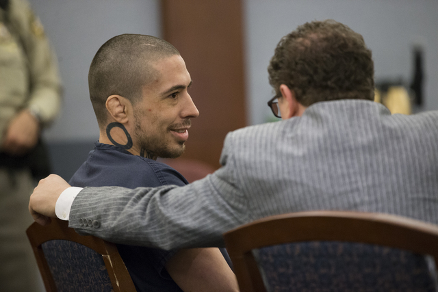 Former mixed martial artist Jonathan Koppenhaver, left, also known as War Machine, facing multiple felony charges for an attack on his ex-girlfriend, Christy Mack, speaks to his defense attorney J ...