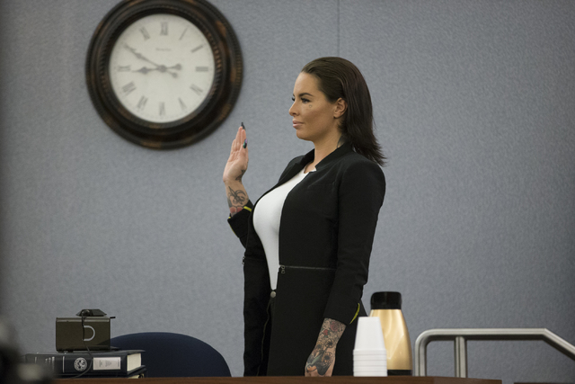 Christy Mack, ex-girlfriend of former mixed martial artist Jonathan Koppenhaver, also known as War Machine, who is facing multiple felony charges for attacking her, appears in court to testify aga ...