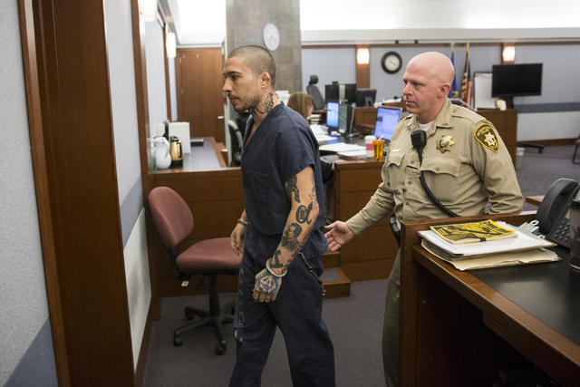 Former mixed martial artist Jonathan Koppenhaver, also known as War Machine, facing multiple felony charges for an attack on his ex-girlfriend, Christy Mack, is escorted out of the courtroom at th ...