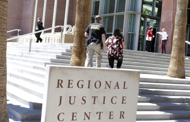 A Clark County marshal and a woman arrive at the Regional Justice Center on 200 Lewis Ave., on Tuesday, Aug. 16, 2016, in Las Vegas. (Bizuayehu Tesfaye/Las Vegas Review-Journal) Follow @bizutesfaye