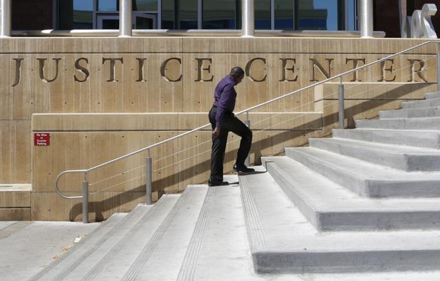 A man arrives at the Regional Justice Center on 200 Lewis Ave., on Tuesday, Aug. 16, 2016, in Las Vegas. (Bizuayehu Tesfaye/Las Vegas Review-Journal) Follow @bizutesfaye