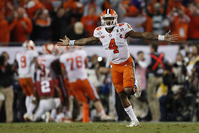 Clemson's Deshaun Watson celebrates a last second touchdown pass to Hunter Renfrow during the second half of the NCAA college football playoff championship game against Alabama Tuesday, Jan. 10, 2 ...