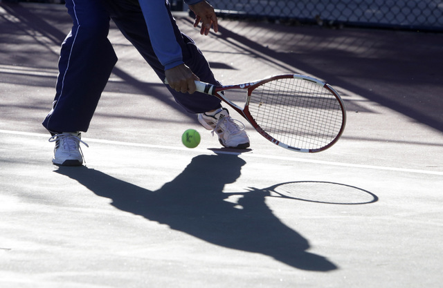 Abe Florence of Henderson returns the ball during sunny but cold morning at Discovery Park Friday, Jan. 27, 2016, in Henderson. (Bizuayehu Tesfaye/Las Vegas Review-Journal) @bizutesfaye