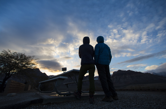 Alison and Mark Peebles of British Columbia take in the sunset from the Red Rock Canyon National Conservation Area overlook outside of Las Vegas on Friday, Jan. 13, 2017. (Chase Stevens/Las Vegas  ...