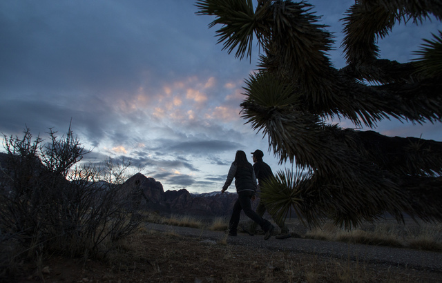 People walk along a trail as the sun sets at Red Rock Canyon National Conservation Area outside of Las Vegas on Friday, Jan. 13, 2017. (Chase Stevens/Las Vegas Review-Journal) @csstevensphoto