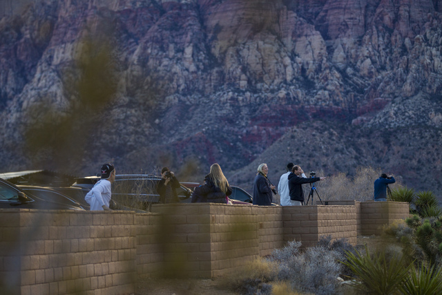 People take in the sunset from the Red Rock Canyon National Conservation Area overlook outside of Las Vegas on Friday, Jan. 13, 2017. (Chase Stevens/Las Vegas Review-Journal) @csstevensphoto