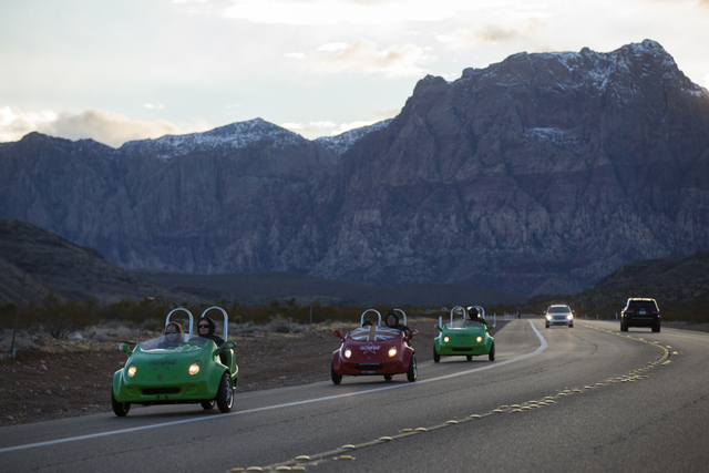 Scooter cars pass through the Red Rock Canyon National Conservation Area outside of Las Vegas on Friday, Jan. 13, 2017. (Chase Stevens/Las Vegas Review-Journal) @csstevensphoto