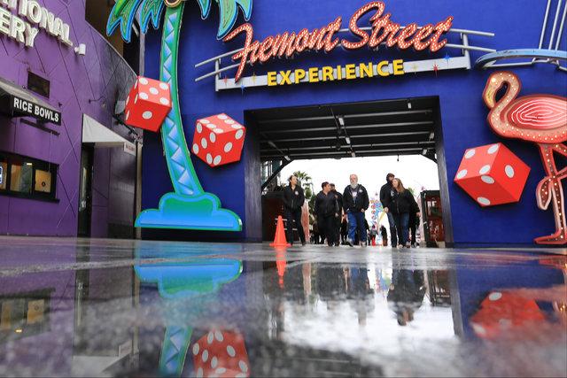 Pedestrians walk along the Fremont Street Experience sign in Las Vegas on Thursday, Jan. 12, 2017. Brett Le Blanc/Las Vegas Review-Journal Follow @bleblancphoto