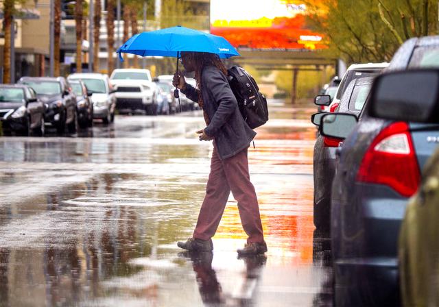 A man walks  during a rain storm at Downtown Summerlin on Friday, Jan. 13, 2017. Jeff Scheid/Las Vegas Review-Journal Follow @jeffscheid