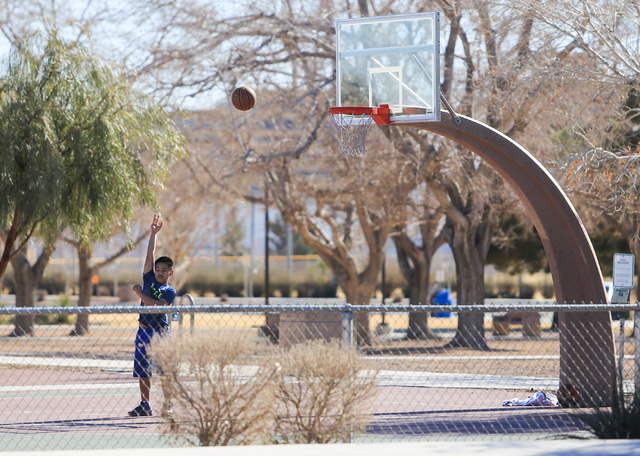 A young boy practices over-the-shoulder shots at Lorenzi Park on Saturday, Jan. 28, 2017, in Las Vegas. Brett Le Blanc/Las Vegas Review-Journal Follow @bleblancphoto