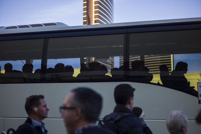 CES attendees board a shuttle at the Sands Expo and Convention Center in Las Vegas on Friday, Jan. 6, 2017. (Chase Stevens/Las Vegas Review-Journal) @csstevensphoto